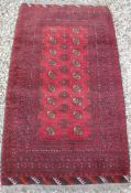 A Turkamen rug with repeating elephant f