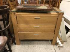 A modern oak chest of three long drawers