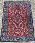 A Persian rug with centre medallion on a