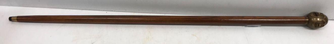 """A modern wooden walking stick with """"Four Faces of Buddha"""" handle"""