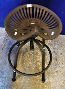 """Two cast iron """"tractor seat"""" stools inscribed """"William Doyle and Co Ltd"""""""