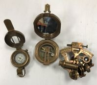A reproduction brass marching compass, a