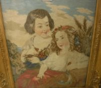 A Victorian needlework panel depicting two young girls with flowers,