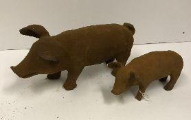A small modern cast iron pig ornament, a