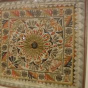An Indian needlework panel with stylised