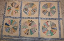 An early 20th Century patchwork quilt of