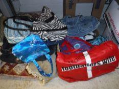 A box containing assorted fashion handba