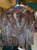A brown mink jacket with satin lining,