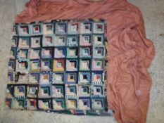 A vintage patchwork quilt mounted as a b