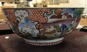 A Qianlong polychrome decorated famille rose bowl with all over decoration of figures in garden
