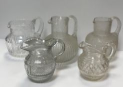 A Georgian pineapple cut glass water jug with engraved bird amongst marguerites,