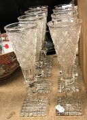 A set of eight hobnail cut glass ale flutes on hobnail cut square bases,