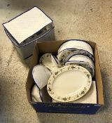 A box containing a Royal Doulton Larchmont part dinner service, to include dinner plates,