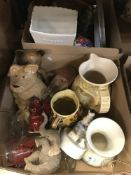Three boxes of assorted sundry items to include various decorative tins, vintage tennis rackets,