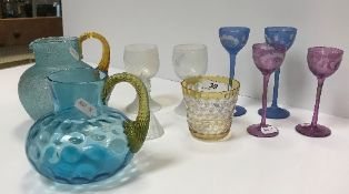 A collection of various other glassware, including opalescent glass roemers,