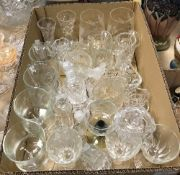 A collection of glassware to include cut glass trumpet shaped vase, a further cut glass vase,