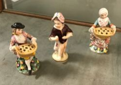 A pair of Höchst miniature figures as lady and gentleman with basket or pot pourri on a floral
