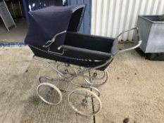 A Silver Cross pram on chrome plated supports and spoke wheels,