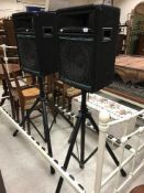 A pair of AC (Audio Concepts) Pro speakers on adjustable tripod stands,