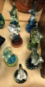 A collection of seven Mdina and Mdina style seahorse paperweights, some signed, ranging from 17.