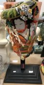 A modern Japanese fabric covered and painted bat depicting a geisha,