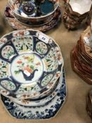 A collection of Oriental wares to include various Imari palette plates,