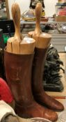 A pair of brown leather riding boots with wooden trees CONDITION REPORTS The size of