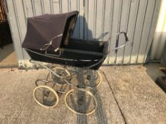 A Silver Cross pram on chrome plated sup