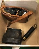 A pair of leather clad binoculars or ope