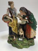 A Derby porcelain figure group as a youn