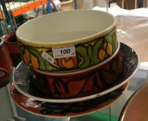 A collection of Poole pottery bowls, pla