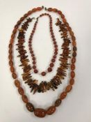 A graduated oval amber bead necklace, ap