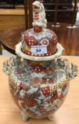 A pair of circa 1900 Japanese Satsuma ware vases and covers with all-over figural decoration and