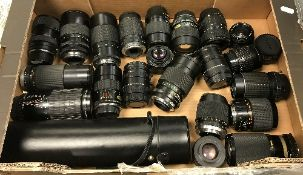 A box containing 22 various camera lenses including a Sigma Super Tele multi-coated 1:5.
