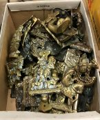 A box containing a collection of various brass door knockers including figural examples - Chaucer