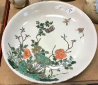 A 19th Century Chinese famille-verte circular dish with blossoming foliage and butterfly decoration,