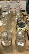 Nine various cut glass decanters and stoppers and a 20th Century Italian Majolica ewer in the