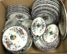 A box containing a Poterat Wedgwood part dinner service to include tureens, soup bowls, etc,