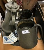 A pewter flagon, two twin-handled pewter loving mugs and a charger,