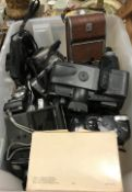 A box containing a collection of various vintage and other cameras including Polaroid Land camera