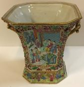 A 19th Century Chinese famille rose and relief work decorated vase of canted square tapered form,