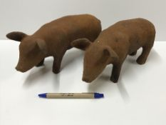 A pair of cast iron Pig ornaments with r