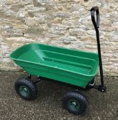 A green plastic garden truck / cargo tro