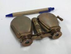 A modern decorative brass folding binocu