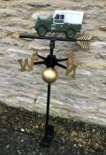 A cast metal weather vane with Landrover