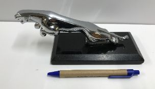 A modern chromed desk ornament in the fo