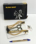 A cast metal sling shot