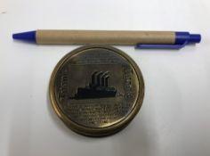 A modern brass pocket compass, the cover