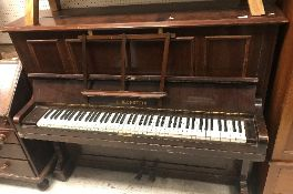 An early 20th Century rosewood cased upright piano,