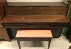 A modern mahogany cased upright piano, the framed iron overstrung movement by Schumann, 137.